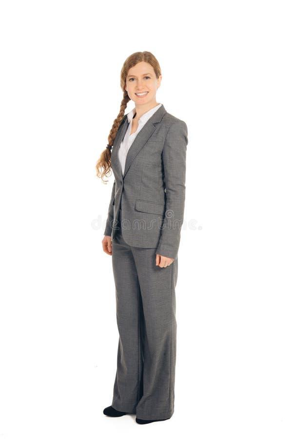 Επιχειρησιακή γυναίκα με την κόκκινη στάση τρίχας στοκ φωτογραφίες