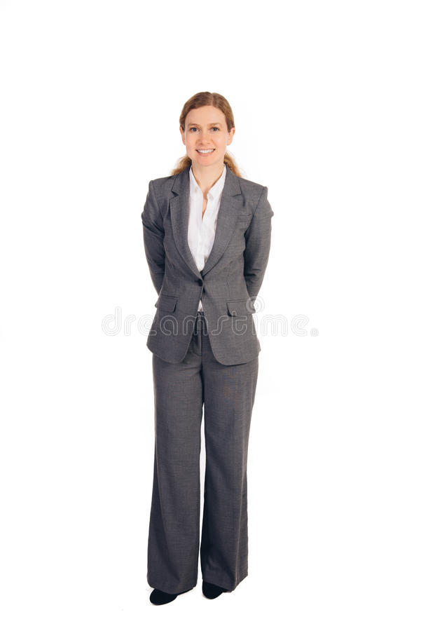 Επιχειρησιακή γυναίκα με την κόκκινη στάση τρίχας στοκ εικόνες