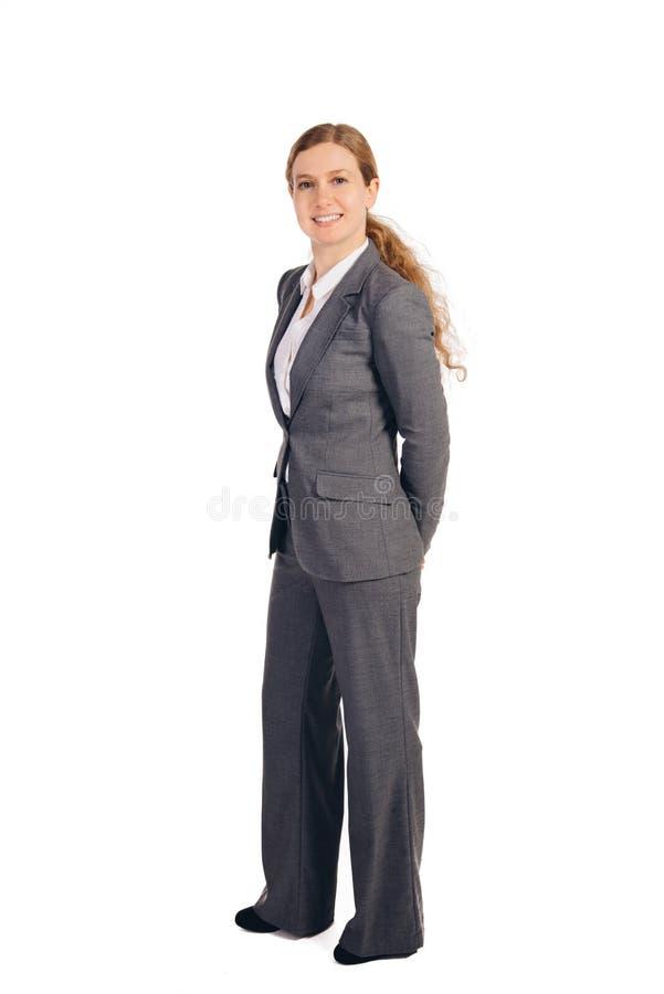 Επιχειρησιακή γυναίκα με την κόκκινη στάση τρίχας στοκ φωτογραφίες με δικαίωμα ελεύθερης χρήσης