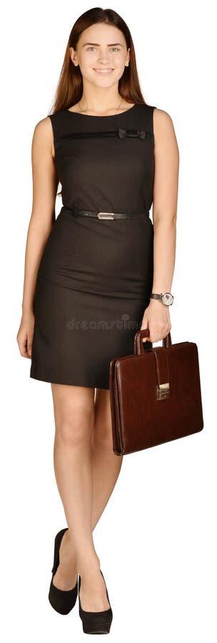 Επιχειρησιακή γυναίκα που κρατά έναν χαρτοφύλακα στο χέρι του στοκ εικόνες