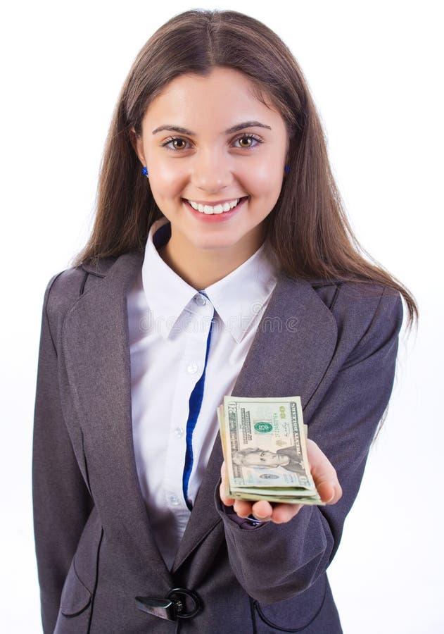 Επιχειρησιακή γυναίκα που προσφέρει τα χρήματα στοκ εικόνες