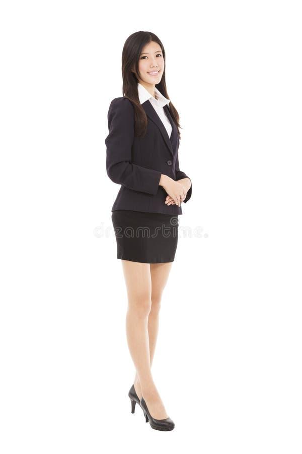 Επιχειρησιακή γυναίκα που στέκεται με απομονωμένος στην άσπρη πλάτη στοκ εικόνα με δικαίωμα ελεύθερης χρήσης