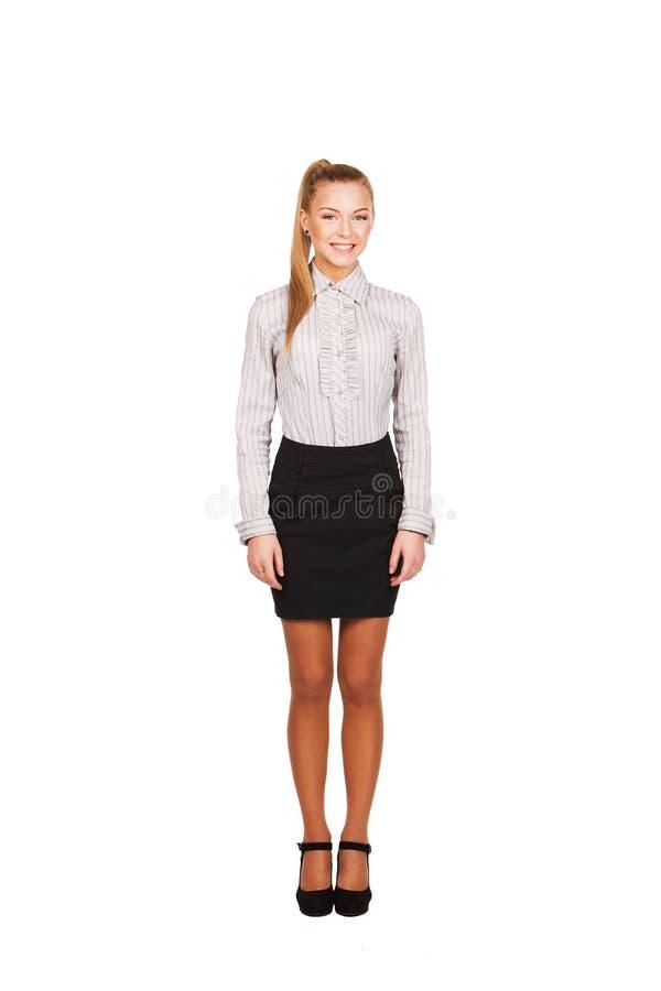 Επιχειρησιακή γυναίκα που στέκεται στο πλήρες μήκος που απομονώνεται στοκ εικόνα