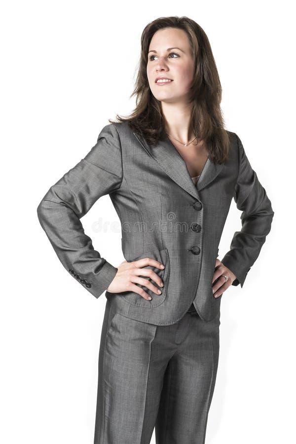 Επιχειρησιακή γυναίκα στο γκρίζο κοστούμι στοκ φωτογραφίες