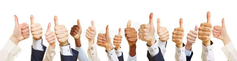 Επιχειρησιακή ομάδα με τους αντίχειρες επάνω στοκ εικόνες με δικαίωμα ελεύθερης χρήσης
