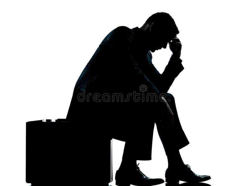 επιχειρησιακό άτομο ένα βαλίτσα συνεδρίασης σκιαγραφιών στοκ εικόνα