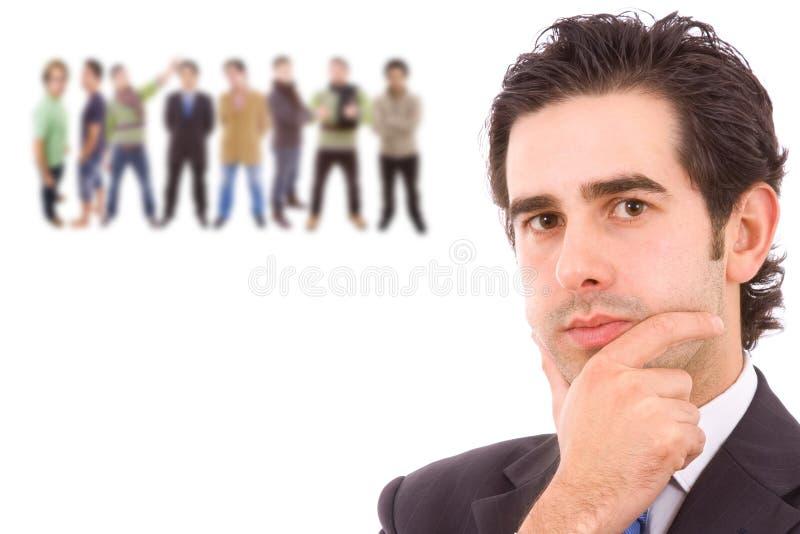 Επιχειρησιακό άτομο με μερικούς ανθρώπους arround στοκ φωτογραφίες