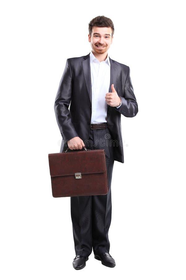 Επιχειρησιακό άτομο με τη στάση χαρτοφυλάκων στοκ εικόνες με δικαίωμα ελεύθερης χρήσης