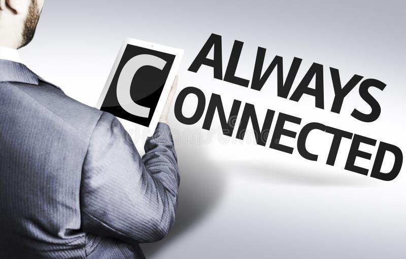 Επιχειρησιακό άτομο με το κείμενο που συνδέεται πάντα σε μια εικόνα έννοιας στοκ φωτογραφία με δικαίωμα ελεύθερης χρήσης