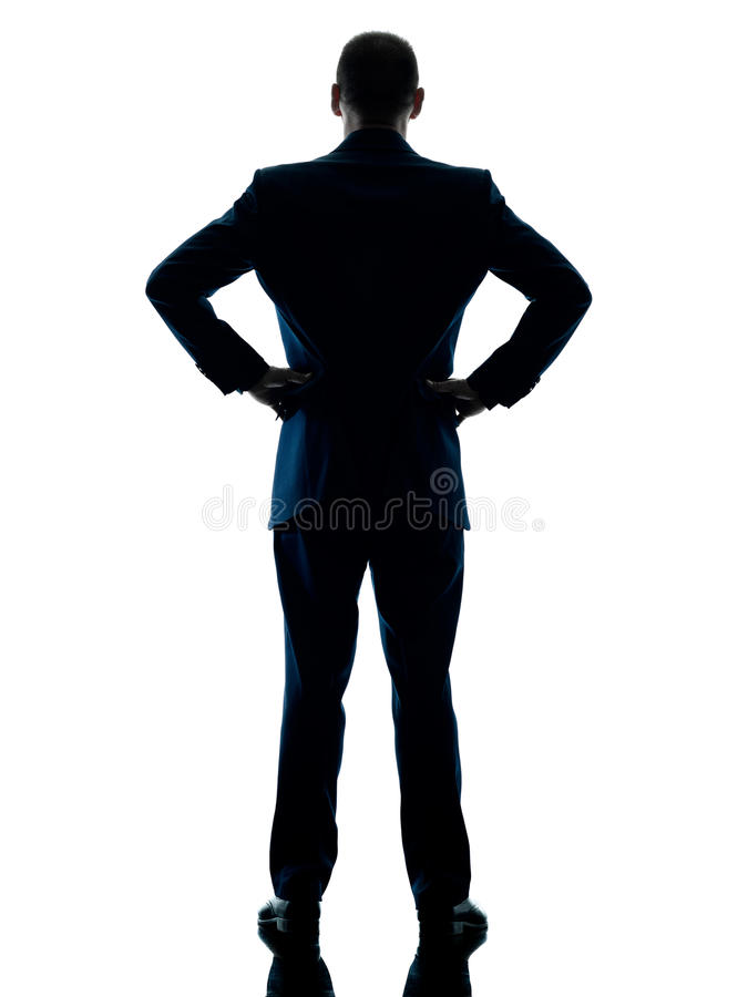 Επιχειρησιακό άτομο οπισθοσκόπο που απομονώνεται που στέκεται στοκ εικόνες