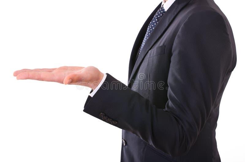 Επιχειρηματίας που παρουσιάζει κενό χέρι. στοκ φωτογραφία