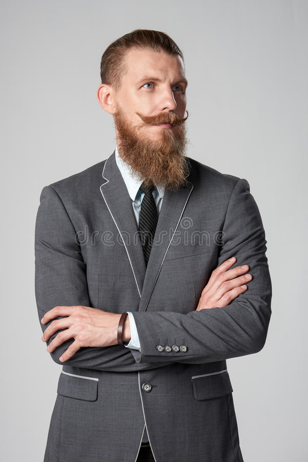 Επιχειρησιακό άτομο Hipster που κοιτάζει από το πλαίσιο στοκ εικόνες με δικαίωμα ελεύθερης χρήσης