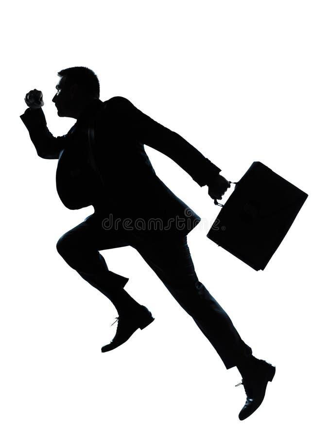 επιχειρησιακό πηδώντας άτομο ένα τρέχοντας σκιαγραφία στοκ φωτογραφία