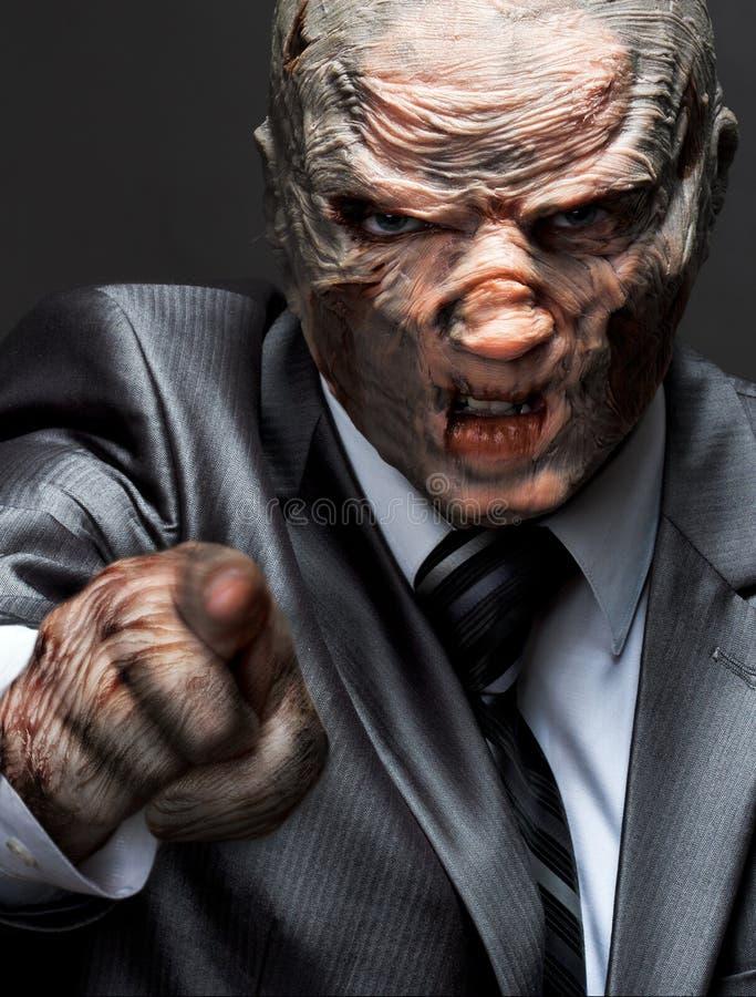επιχειρησιακό τέρας που δείχνει το κοστούμι σας στοκ φωτογραφία με δικαίωμα ελεύθερης χρήσης