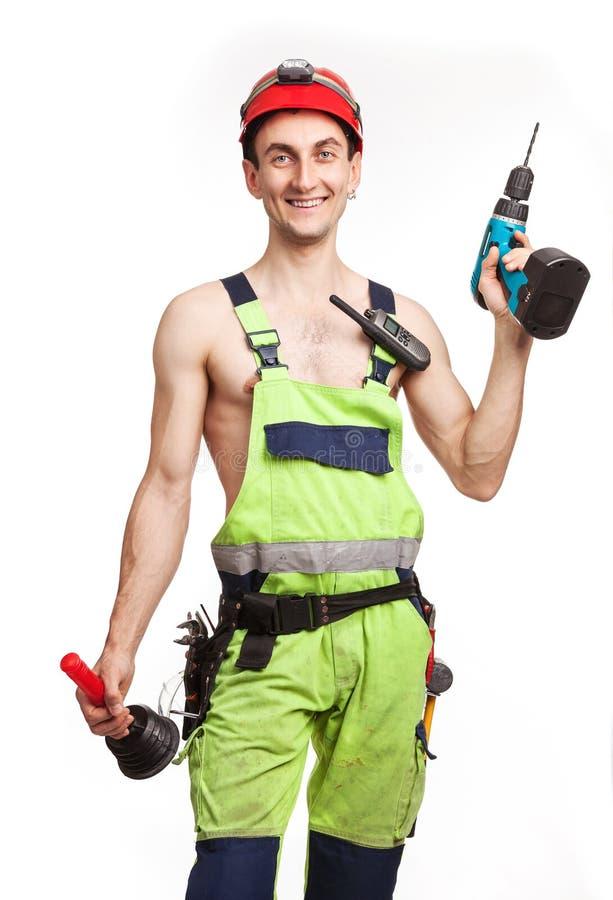 Εργάτης ανοικτό πράσινο σε ομοιόμορφο στοκ εικόνα με δικαίωμα ελεύθερης χρήσης