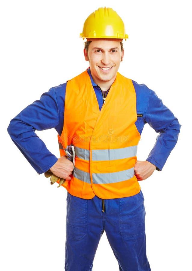Εργάτης οικοδομών με hardhat και ασφάλειας τη φανέλλα στοκ εικόνα