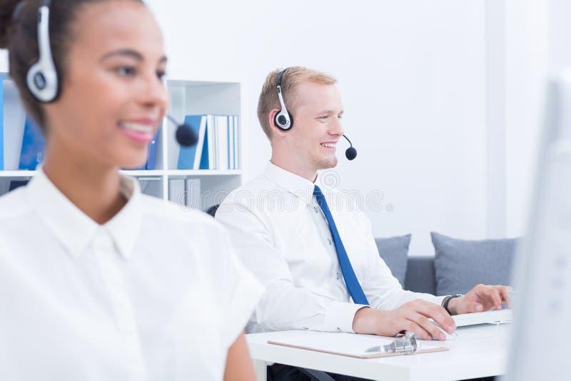 Εργαζόμενοι εξυπηρέτησης πελατών στοκ εικόνες