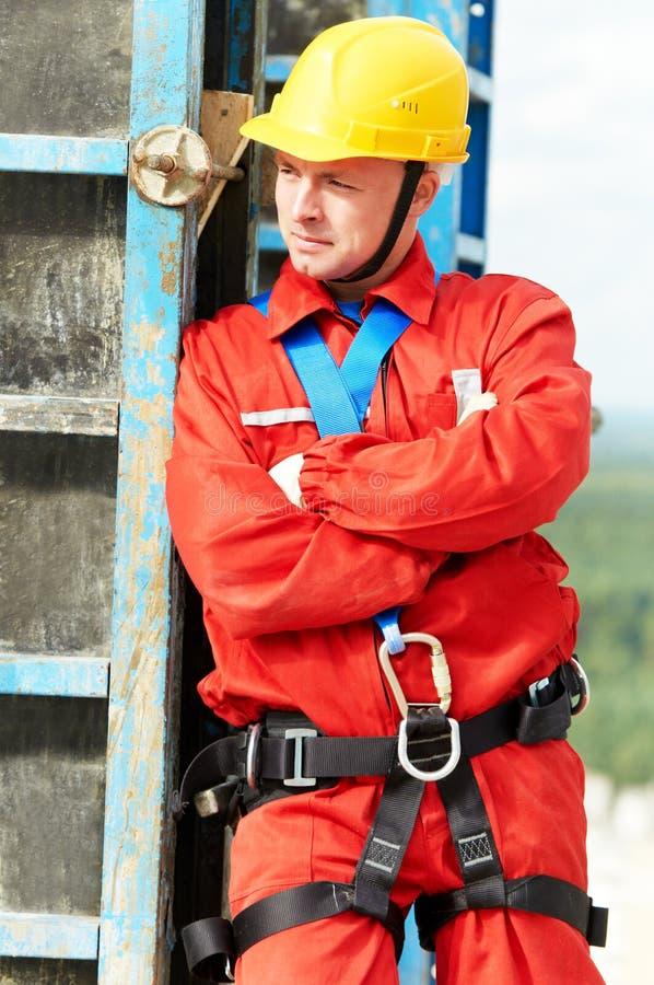 εργαζόμενος εργοτάξιων οικοδομής οικοδόμων στοκ φωτογραφία