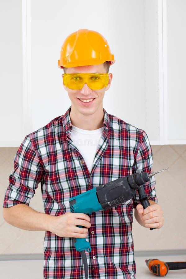 Εργαζόμενος με perforator στοκ φωτογραφίες με δικαίωμα ελεύθερης χρήσης