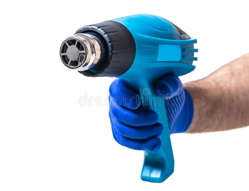 Εργαλείο κατασκευής, hairdryer στο αρσενικό χέρι στοκ φωτογραφία