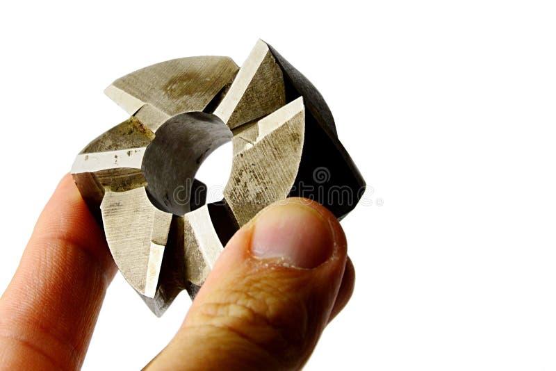 Εργαλείο κοπτών άλεσης χαρακτήρων κοχυλιών έξι λεπίδων από το χάλυβα υψηλής ταχύτητας, ελαφρώς χρησιμοποιούμενο, που κρατιέται στ στοκ εικόνα