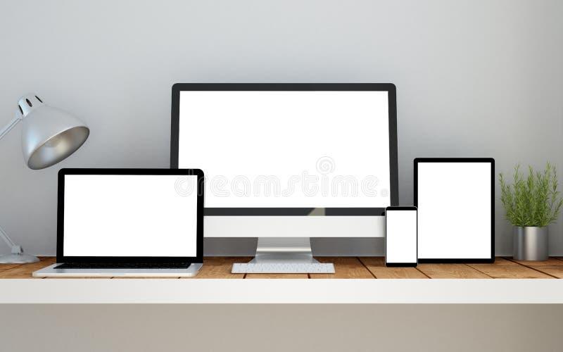 εργασιακός χώρος με τον απαντητικό ιστοχώρο οθόνης σχεδίου κενό στις συσκευές απεικόνιση αποθεμάτων