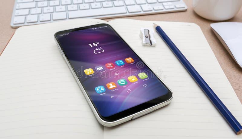 Εργασιακός χώρος με το σύγχρονο κινητό τηλέφωνο απεικόνιση αποθεμάτων