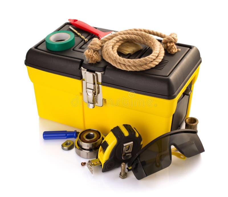 Εργαλεία και όργανα με την εργαλειοθήκη στο λευκό στοκ εικόνα με δικαίωμα ελεύθερης χρήσης