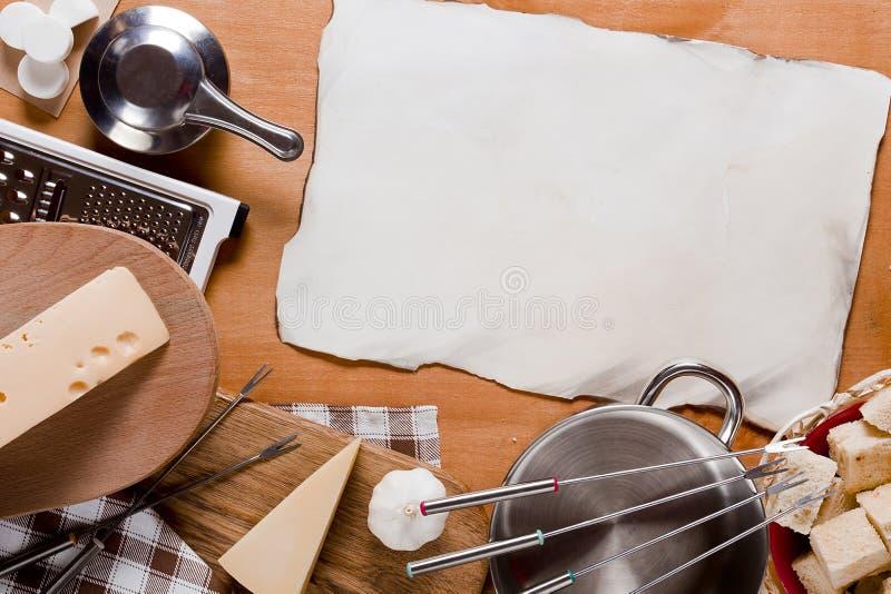 Εργαλεία και Fondue τροφίμων στοκ εικόνα με δικαίωμα ελεύθερης χρήσης