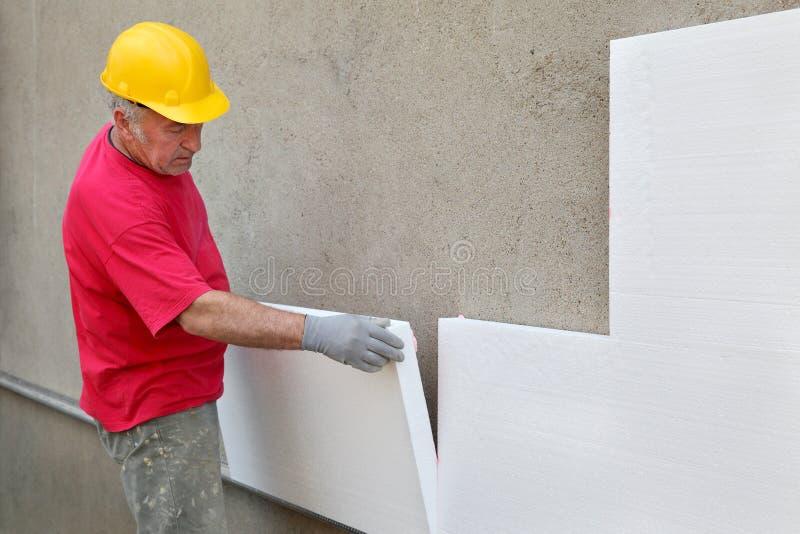 Εργοτάξιο οικοδομής, θερμική μόνωση του τοίχου στοκ φωτογραφία