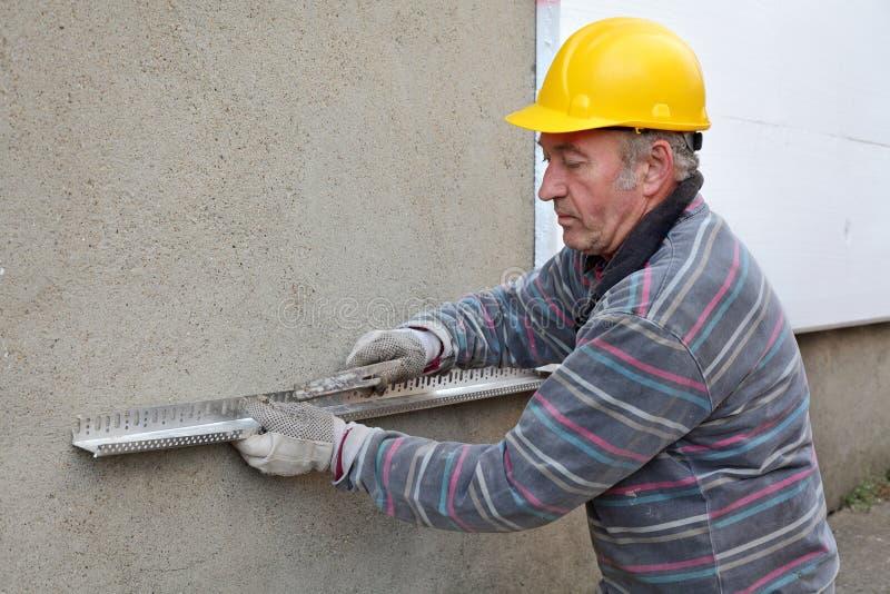 Εργοτάξιο οικοδομής, θερμική μόνωση του τοίχου στοκ φωτογραφίες