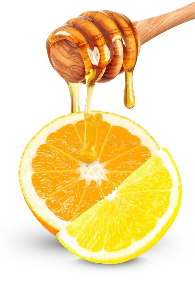 Εσπεριδοειδή και μέλι στοκ φωτογραφία