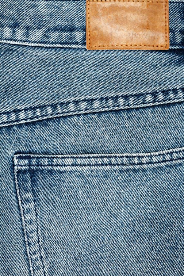 Ετικέτα που ράβεται το τζιν παντελόνι στοκ φωτογραφία