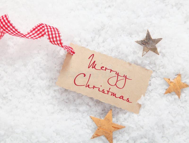 Ετικέττα δώρων με το χαιρετισμό Καλών Χριστουγέννων στοκ εικόνα
