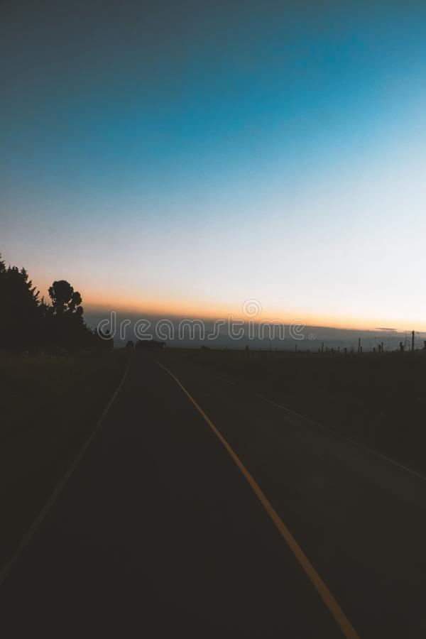 Ευμετάβλητη διπλή μεταφορά Kodak ηλιοβασιλέματος οδικής ανατολής στοκ φωτογραφίες με δικαίωμα ελεύθερης χρήσης