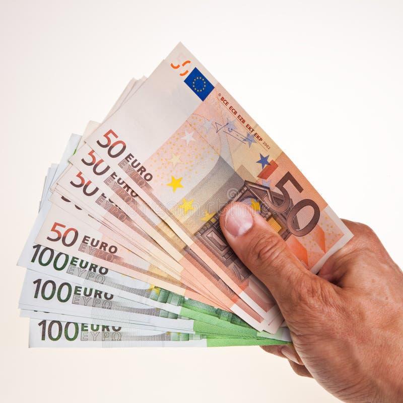 ευρο- λαβή χεριών 50 100 τραπε&zet στοκ εικόνα