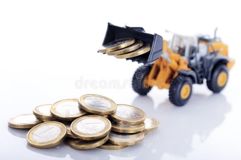 Ευρο- νομίσματα και φορτωτής χρημάτων στοκ εικόνες
