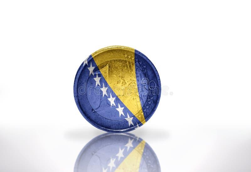 Ευρο- νόμισμα με τη βοσνιακή σημαία στο λευκό στοκ εικόνα