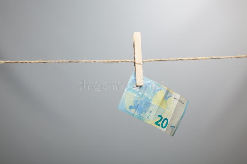 Ευρο- νόμισμα της νομικής προσφοράς, για να αγοράσει μέσα την αγορά στοκ φωτογραφία