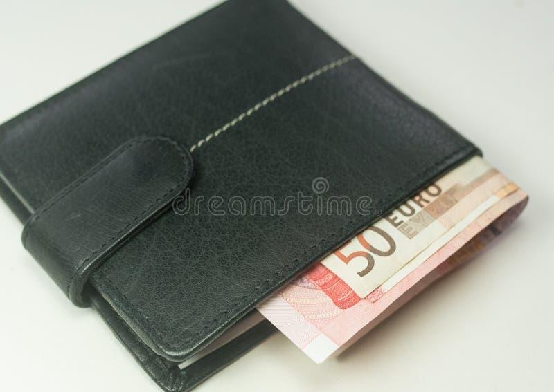 Ευρο- τραπεζογραμμάτια μέσα σε ένα μαύρο πορτοφόλι στοκ εικόνα με δικαίωμα ελεύθερης χρήσης