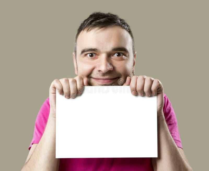 Ευτυχές άτομο με την άσπρη αφίσσα στοκ φωτογραφία με δικαίωμα ελεύθερης χρήσης