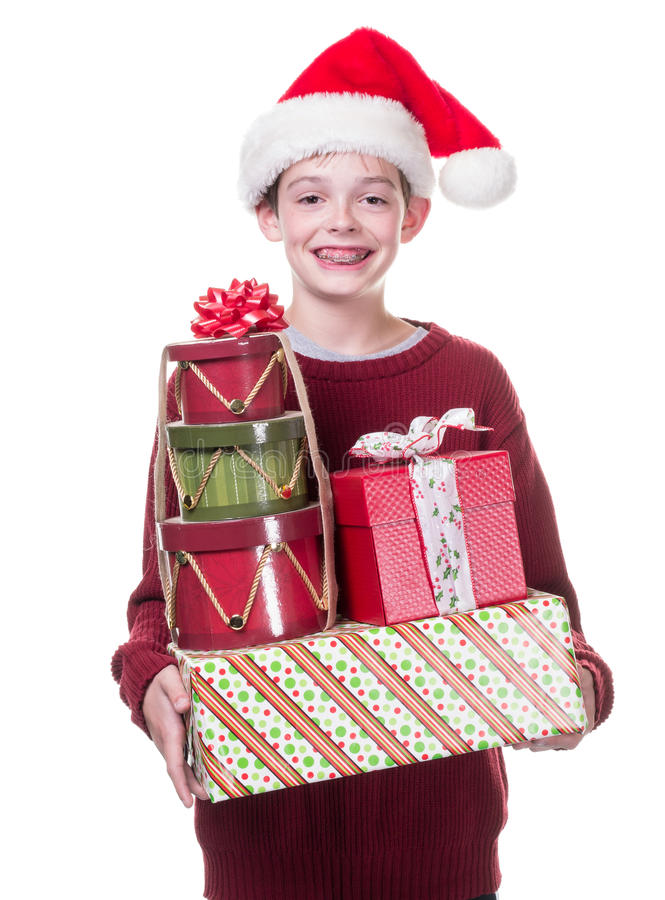 Ευτυχές αγόρι με το σύνολο βραχιόνων των δώρων Χριστουγέννων στοκ φωτογραφία με δικαίωμα ελεύθερης χρήσης