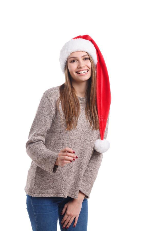 Ευτυχές κορίτσι Χριστουγέννων που φορά ένα καπέλο santa που απομονώνεται σε ένα άσπρο υπόβαθρο Έννοια διακοπών στοκ εικόνα με δικαίωμα ελεύθερης χρήσης