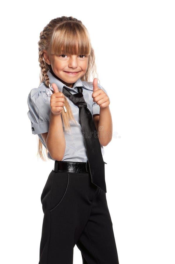 Ευτυχές μικρό κορίτσι με τους αντίχειρες επάνω στοκ φωτογραφία με δικαίωμα ελεύθερης χρήσης