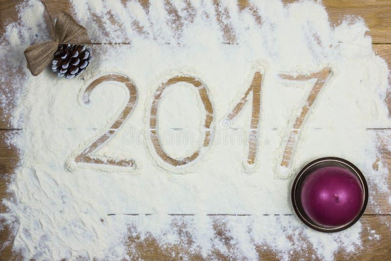 Ευτυχές νέο έτος του 2017 στο αλεύρι, ξύλινο υπόβαθρο στοκ φωτογραφία με δικαίωμα ελεύθερης χρήσης