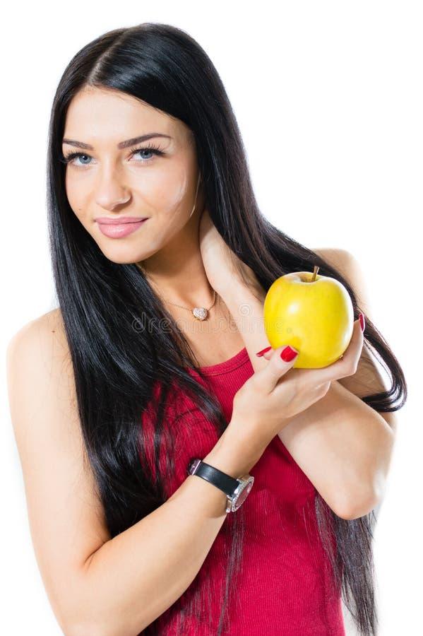 Ευτυχές νέο μήλο εκμετάλλευσης γυναικών που απομονώνεται στο άσπρο υπόβαθρο στοκ εικόνα