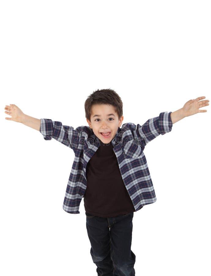 Ευτυχές παιδί που τρέχει με τις ανοικτές αγκάλες στοκ εικόνα με δικαίωμα ελεύθερης χρήσης