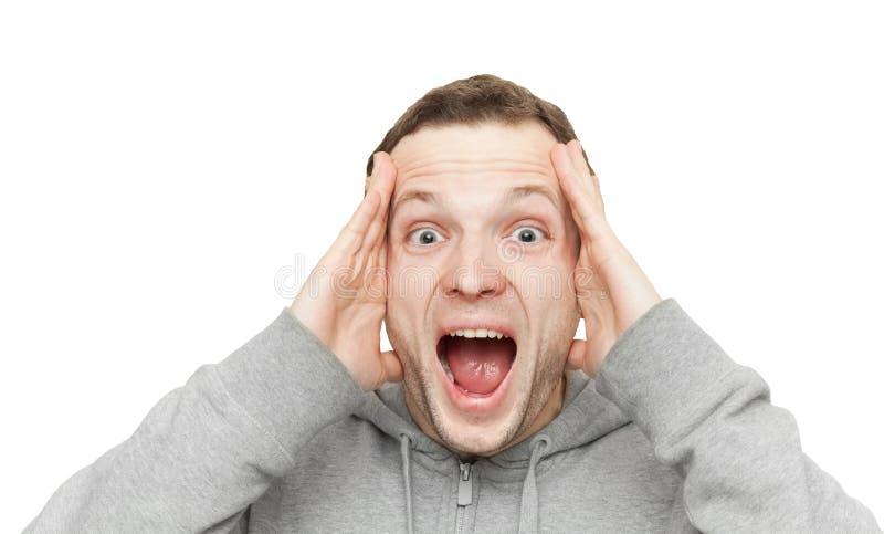 Ευτυχές φίλαθλο νέο καυκάσιο άτομο που κρατά το κεφάλι του στοκ φωτογραφία
