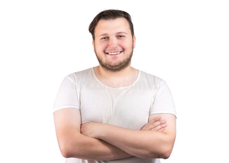 Ευτυχές chubby άτομο με τα όπλα που διασχίζονται στοκ εικόνα
