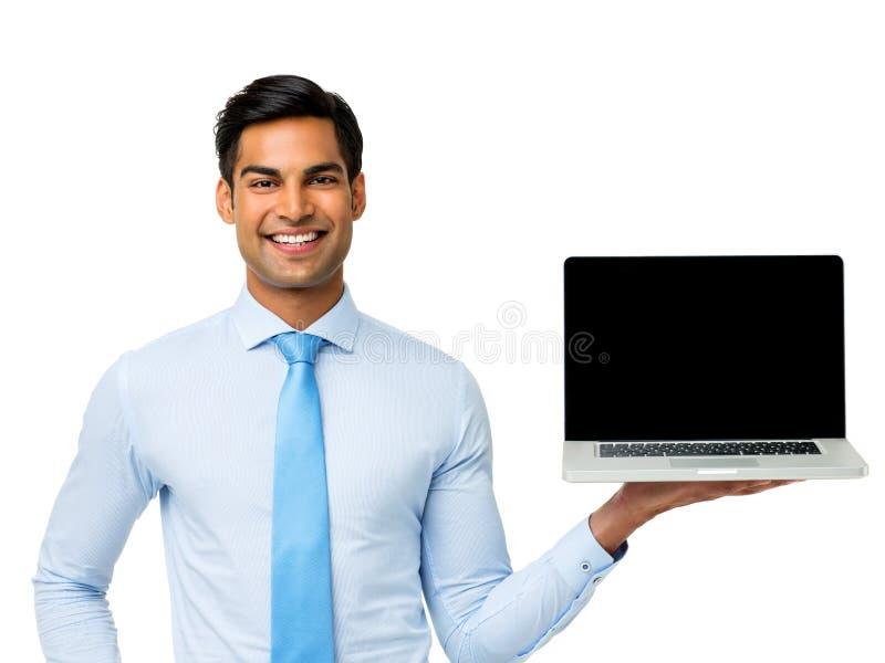 Ευτυχές lap-top εκμετάλλευσης επιχειρηματιών στοκ εικόνα με δικαίωμα ελεύθερης χρήσης